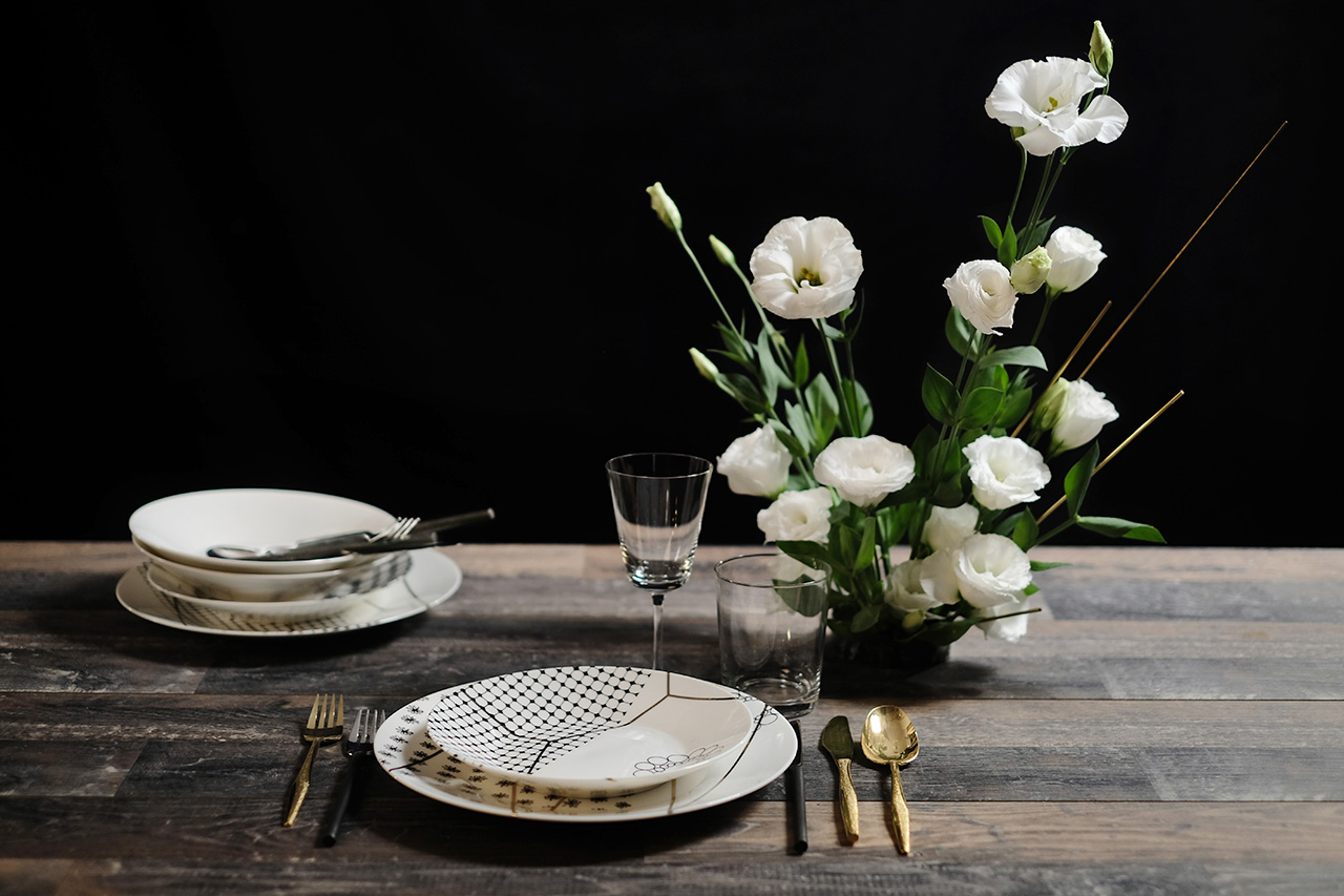 Gold dinner set and flower centerpiece